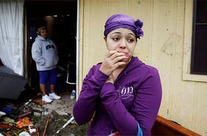 A resident looks at the damage caused by a tornado that ripped through the Dallas suburb of Lancaster, Texas.
