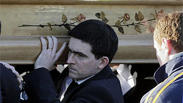Michaela's brother Mark Harte carries her coffin from their parents' home in Ballygawley. Photo: PA