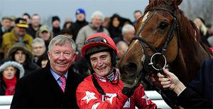 Alex Ferguson congratulates jockey Daryl Jacob wearing his colours after Harry The Viking won the Lynn Higgins 60th Birthday Novices Ltd Handicap   at Doncaster