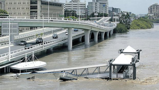 A jetty is flooded in Brisbane, Australia, yesterday as evacuations got under way in several towns and suburbs in and around Queensland's capital