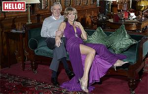 Bill Roache and his girlfriend Emma Jesson, appearing in Hello Magazine, who has warned him not to return to his womanising ways