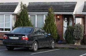 Gardai at the scene where a drug dealer and a teenager have been murdered in a gangland-style gun attack in Rochford Avenue, Kilcock, Co Kildare. Photo: PA