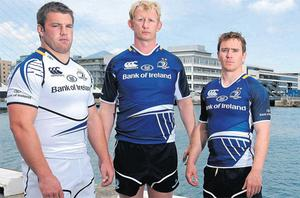 Sean O'Brien, left, Leo Cullen and Eoin Reddan, right, at the launch of Leinster's new home and away jerseys for the upcoming season in Dublin yesterday