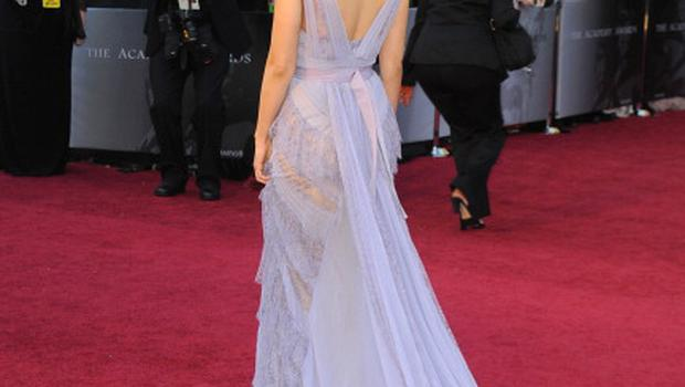 HOLLYWOOD, CA - FEBRUARY 27:  Actress Mila Kunis arrives at the 83rd Annual Academy Awards held at the Kodak Theatre on February 27, 2011 in Hollywood, California.  (Photo by Frazer Harrison/Getty Images)