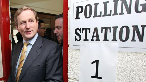 Irish Opposition leader Enda Kenny of the Fine Gael party leaves the polling station after casting his vote with his family at St Patricks National school in Castle bar, in north-west Ireland. Photo: Getty Images