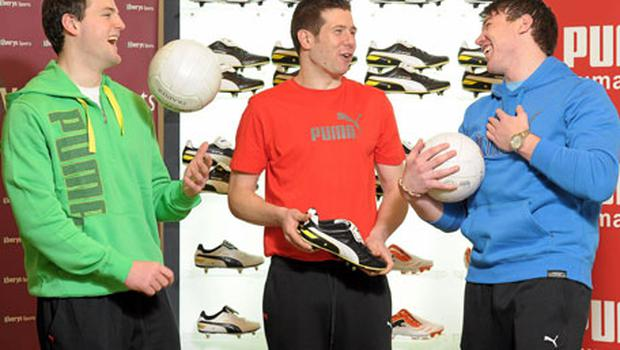 Donegal footballer Michael Murphy, left, Tyrone's Sean Cavanagh and Dublin's Eamon Fennell at yesterday's launch of the new Puma KING Finale boot in Dundrum.