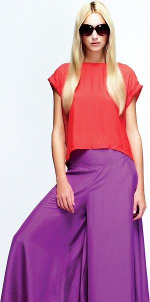 Red silk cap-sleeved top, €24.99; silk wide-leg trousers, €37. 99, and sunglasses, €9.99, all New Look