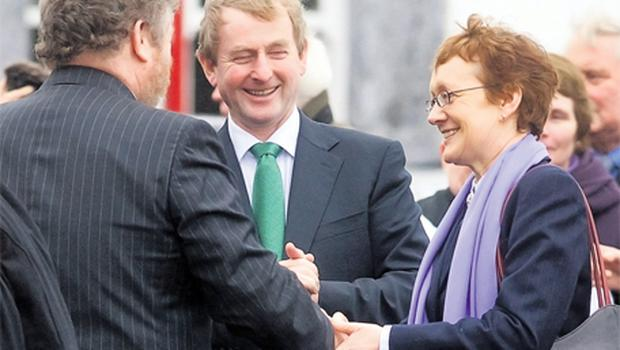 Taoiseach Enda Kenny with Health Minister James Reilly and Attorney General Maire Whelan at her mother's funeral in Kinvara, Co Galway