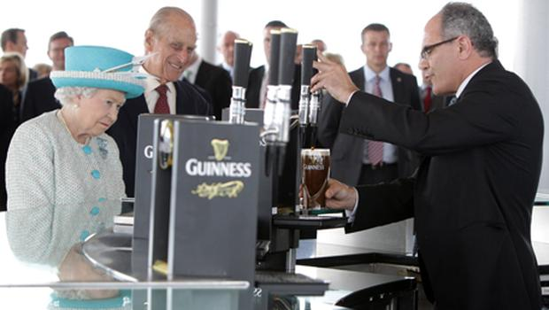 The Queen and Prince Philip watch the pouring of a pint at the Guinness Brewery during their Irish visit. Photo: Getty Images