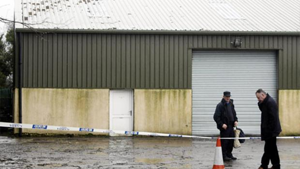 Gardai at the scene in Durrow Co Offaly after one of the biggest cannabis factories discovered in Ireland was raided. Photo: PA
