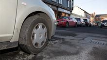 Cars struggle to cope with pothole damage yesterday following the December freeze on Henry Street, Newbridge, Co Kildare