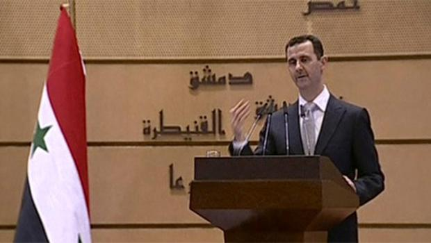 Syrian President Bashar Assad delivers a speech in Damascus