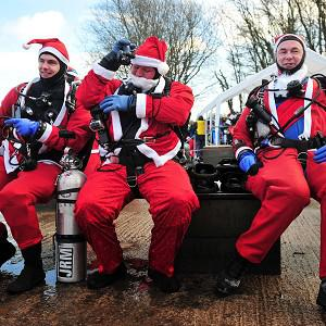 More than 160 people donned Santa costumes for a charity dive in Somerset