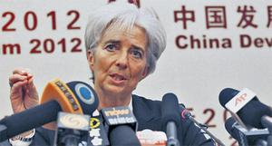 Christine Lagarde at a news conference after attending the China Development Forum 2012 in Beijing yesterday