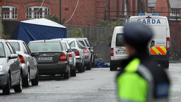 Garda and forensic officers at the scene off Blackhorse Avenue in Dublin. Photo: PA