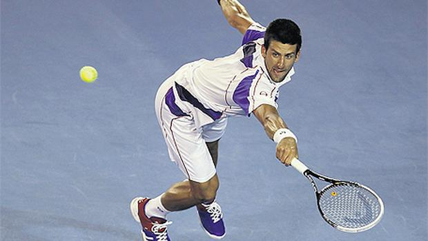Serbia's Novak Djokovic plays a shot during yesterday's victory over Tomas Berdych at the Australian Open