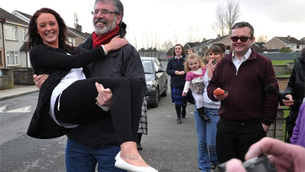Gerry Adams meets Talitha Carroll while on the campaign trail in the Greenacres estate in Dundalk, Co Louth