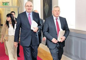Environment Minister Phil Hogan arrives with Fergus O'Dowd TD for a press briefing yesterday evening