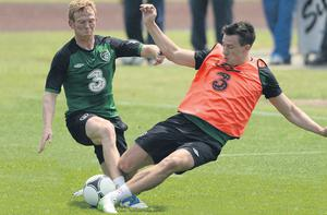 There was no holding back at the Irish training session in Montecatini yesterday as Sean St Ledger's crunching tackle on Paul Green shows