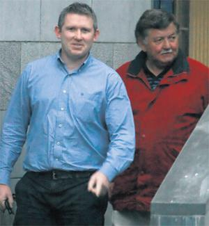 Former Limerick hurler Mark Foley leaves Limerick District Court with his uncle Jerry Foley