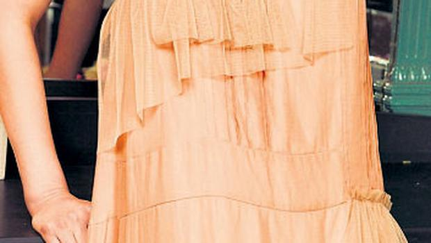 Peach silk tulle tiered dress, €390, See by Chloe; hair flower, stylist's own