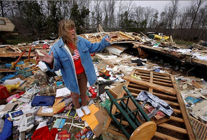 Tracy Pitman describes what it was like to survive the tornado in her home with her husband and grandson in East Bernstadt, Kentucky, March 4, 2012. Photo: Reuters