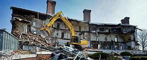 A bulldozer is used to demolish the 'Land's End' mansion in Sands Point, Long Island. Photo: AP