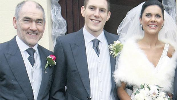 Michaela Harte at her wedding with new husband John McAreavey and dad Mickey Harte