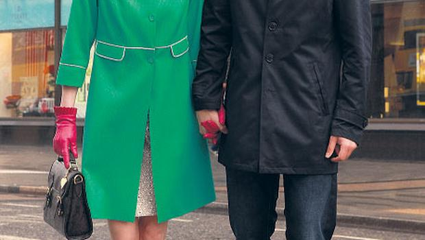 She wears: apple green coat, €165, Daisy May; dress (underneath), €189, Kate Cooper; black pumps, €75, Gabor; marcasite earrings, €39.95, Gold Major; pink leather gloves, €79, Dents; vintage box bag €59, Carousel. He wears: navy trench coat, €89.95, Selected Homme; red polo shirt, €55, Tommy Hilfiger; jeans, €99.90, Tommy Hilfiger; black brogues, €110, Rockport; red tie, €22.50, Barbour