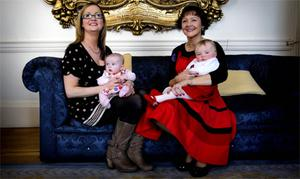 Double lung transplant recipient Anita Ainsworth, from Galway, (left) with her daughter Evey and Heart, Lung and Kidney transplant recipient Deirdre Roche Doherty, from Co Kilkenny, with her daughter Ruth, enjoy a cup of tea in the Mansion House, Dublin