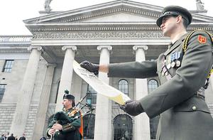 Captain Shane Keogh reads the Proclamation at a ceremony to mark the 96th anniversary of the 1916 Easter Rising outside the GPO in Dublin last weekend.