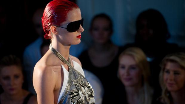 LONDON, ENGLAND - SEPTEMBER 17:  A model walks down the runway during the Julien Macdonald fashion show at London Fashion Week Spring/Summer 2012 on September 17, 2011 in London, United Kingdom. (Photo by Ian Gavan/Getty Images)