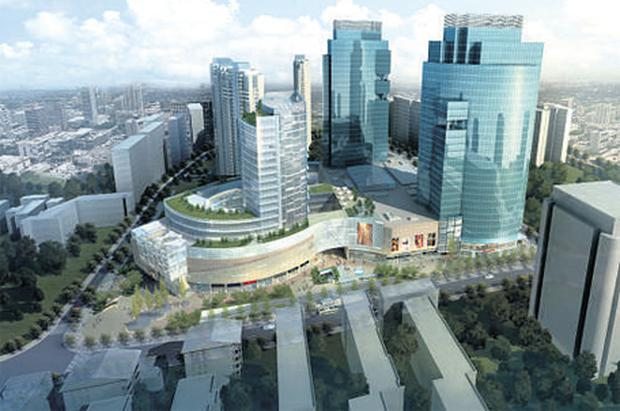 An artist's impression of the new City Centre development in Shanghai, a key asset of the Chinese property group backed by Treasury Holdings. Below: Treasury's Richard Barrett and Johnny Ronan