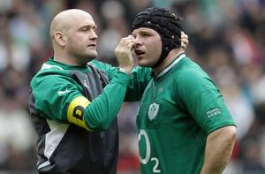 Ireland's Mike Ross gets treatment for a cut