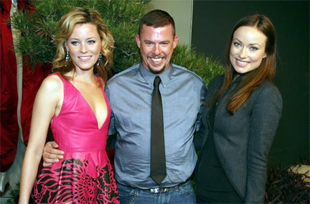 Delicate situation: Alexander McQueen, who died last year, pictured with actresses Elizabeth Banks and Olivia Wilde