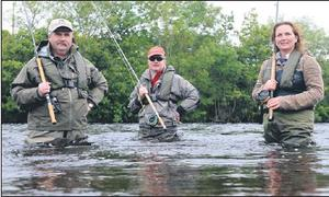 Gone fishing . . . Glenda Powell, of Blackwater Lodge, with fishermen teaching the art of fishing with Tom Ankettell and Stewart Stephens on the banks of the River Laune on Friday. Credit: Photo by Michelle Cooper Galvin