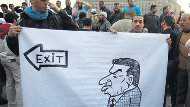Protesters hold a banner during a demonstration in Cairo yesterday