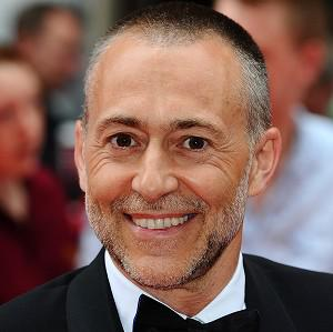 Top chef Michel Roux has beaten comedian Ricky Gervais by a whisker to the title of Beard of Winter