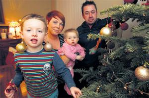 Stephanie Meehan and her partner Fiachra Daly, with their son Oisin (6) and nine-monthold Cerys in their temporary accommodation in Belmayne, Dublin. Photo: Collins