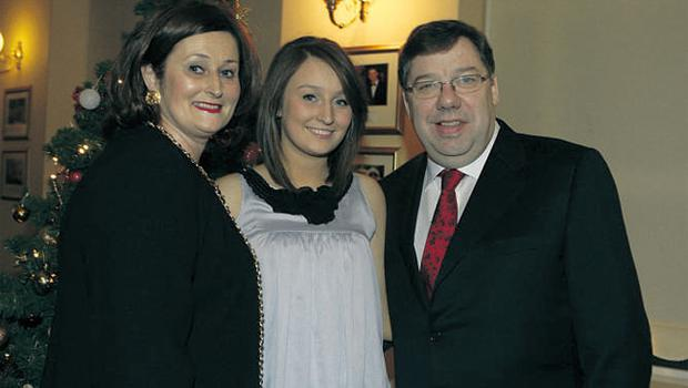 Taoiseach Brian Cowen poses with his wife Mary and daughter Sinead at the Fianna Fail fundraising Christmas dinner at the Citywest Hotel, Dublin, last night