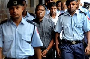 Murder accused Sandip Moneea closely followed by Avinash Treebhoowoon leaving the Supreme Court in Mauritius