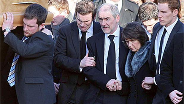 Matthew, Mickey and Marian Harte following Michaela's coffin with John McAreavey