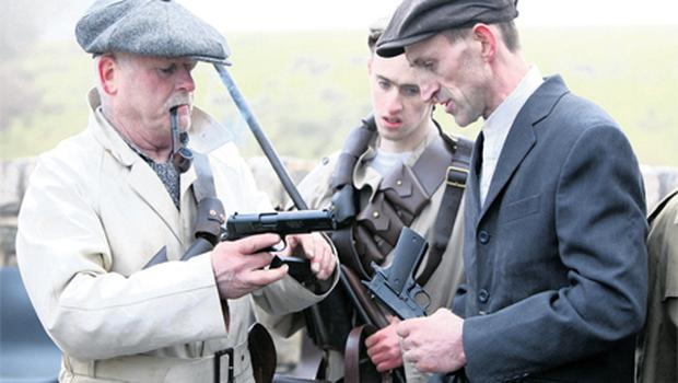 Tom Burnell and George Buckley check their guns in Glenwood, Co Clare, yesterday