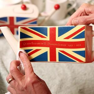 Carol Bridges completes a teapot celebrating the Queen's Diamond Jubilee
