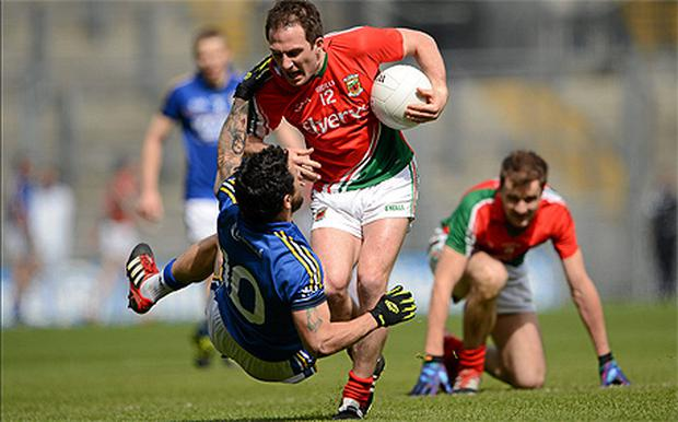 Alan Dillon is tackled by Kerry's Paul Galvin