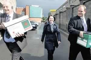 BOXED UP: Competition Authority officials take away evidence from last Friday's raid on the IFA's Farm Centre headquarters in Dublin