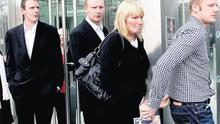 Raymond Bates's widow Brenda leaving court yesterday with her sons (from left) Mark, Karl and Paul.
