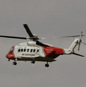 A man had to be rescued after becoming stuck up to his neck in mud in waters off Portsmouth, the Coastguard said