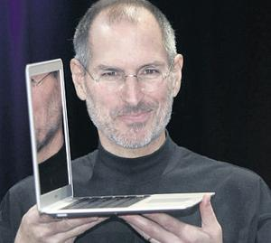 Former Apple CEO Steve Jobs holds up the MacBook Air after his keynote at the 2008 MacWorld Conference in San Francisco