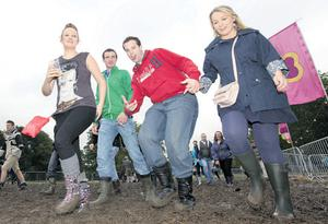 Well-behaved fans brave the mud at last night's concert in the Phoenix Park